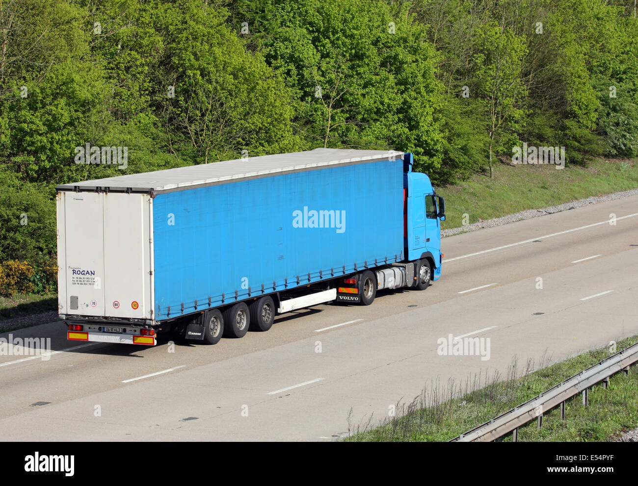 A Rogan articulated truck traveling along the M20 motorway in Kent, England - Stock Image