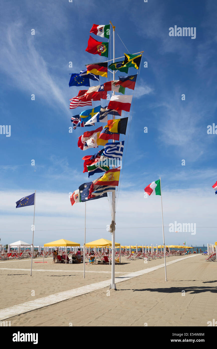Assortment of national flags on beach flagpole, Viareggio, Tuscany, Italy, Europe Stock Photo