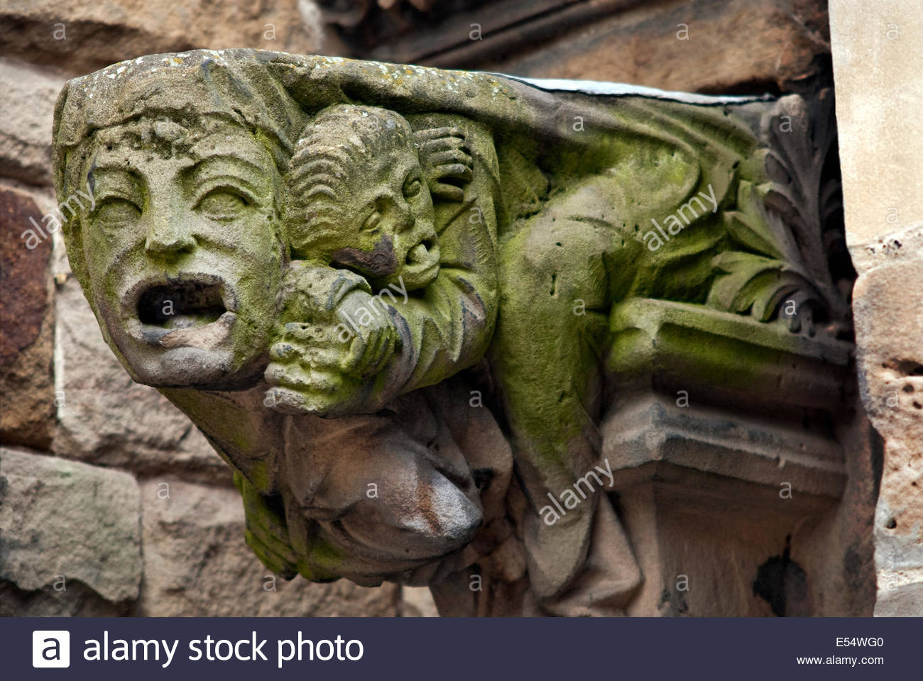 Architectural detail of St.Martin Church in Birmingham, England, showing a stone face in fear. - Stock Image