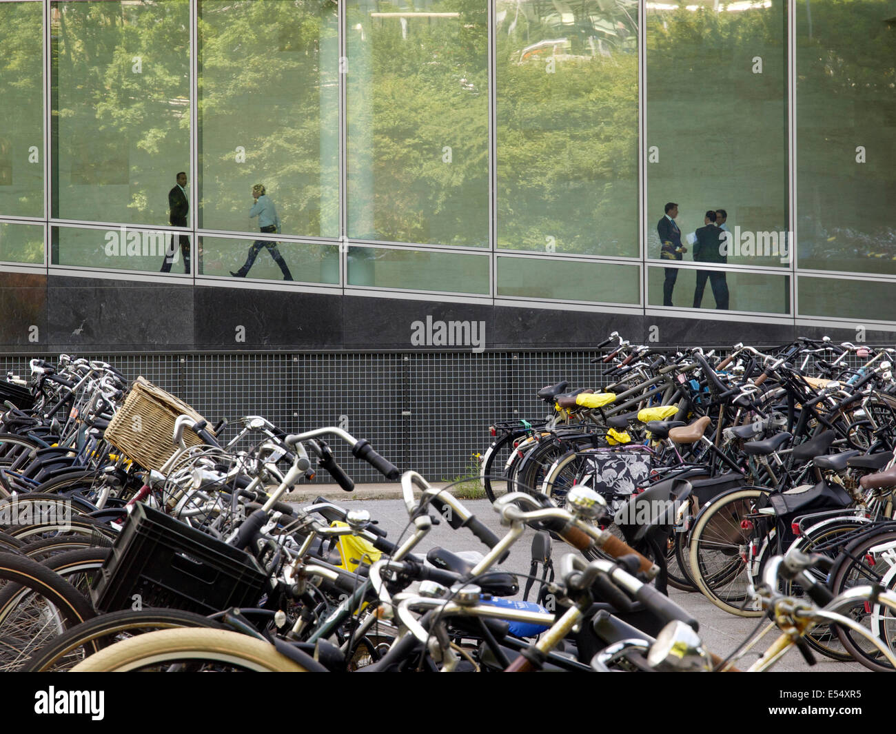 The bicycle is a popular commuting option for office workers in Amsterdam, the Netherlands - Stock Image