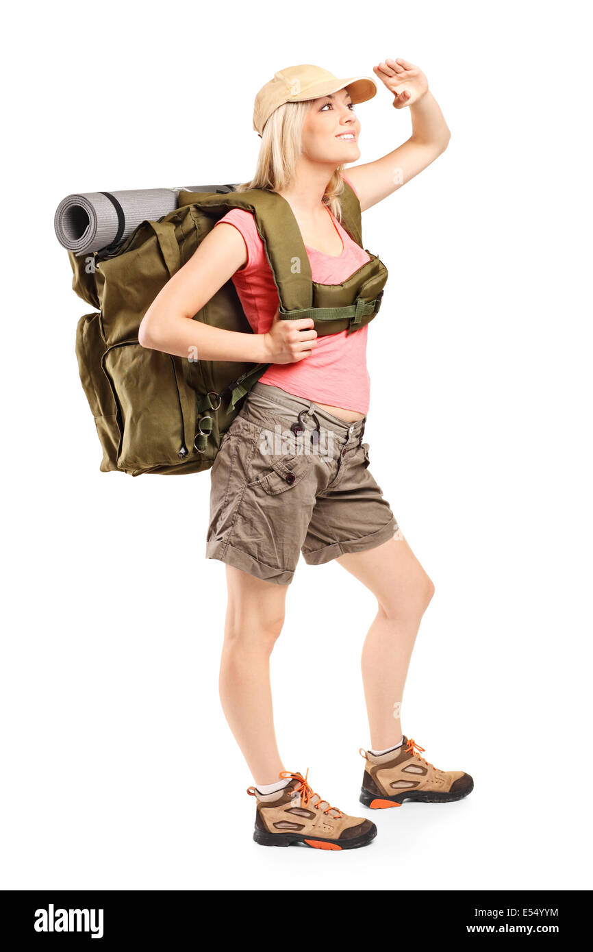 Full length portrait of a female hiker looking up - Stock Image