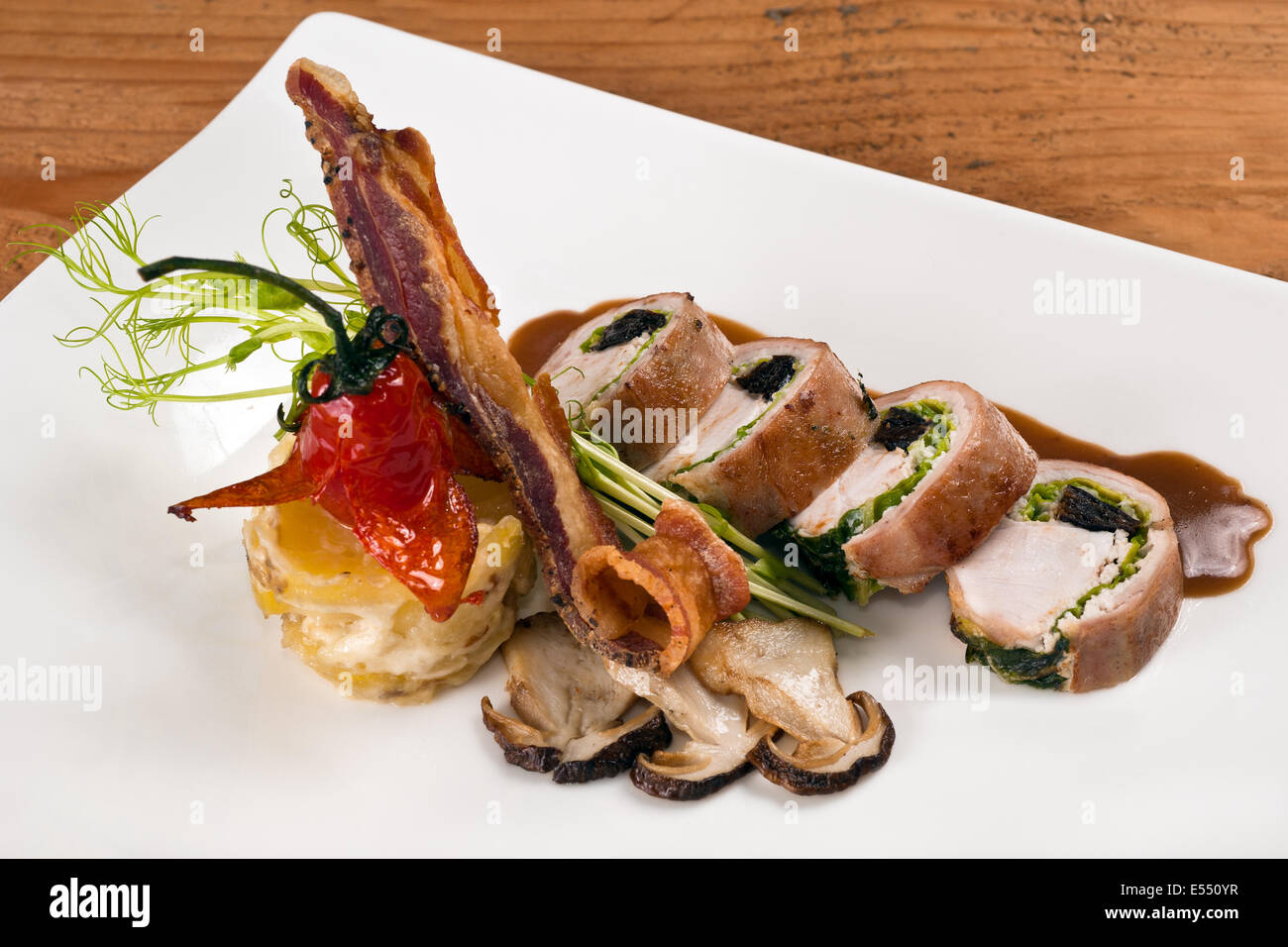 Loin of rabbit with bacon and mushrooms - Stock Image