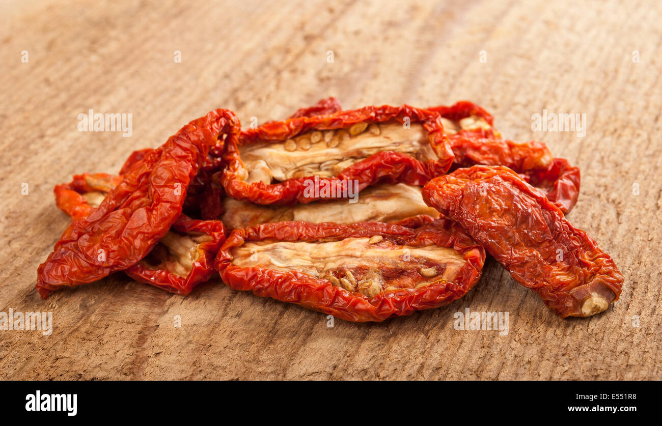 Dried tomatoes  on wood background. - Stock Image