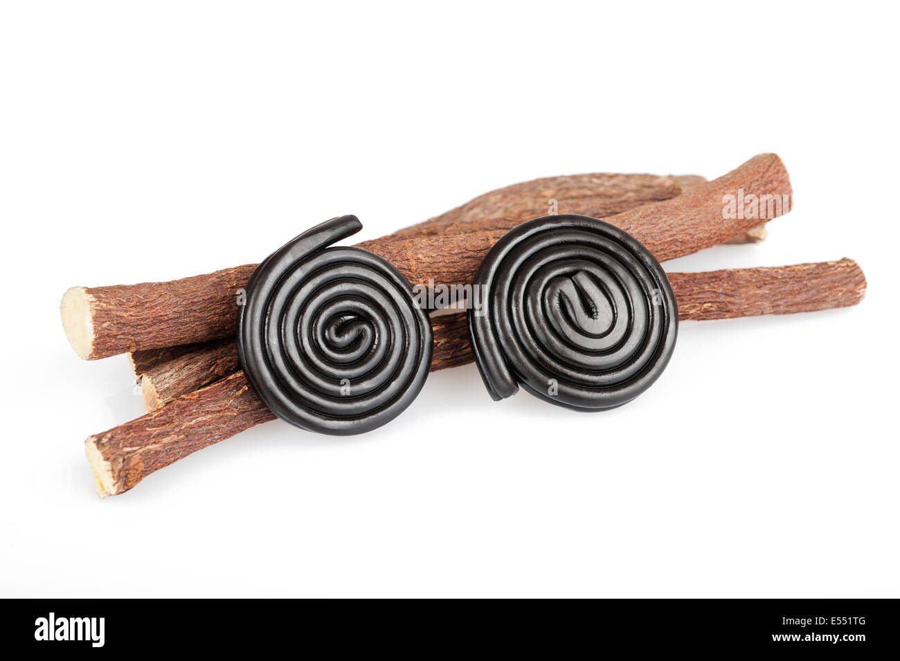 Licorice roots and wheels isolated on white - Stock Image