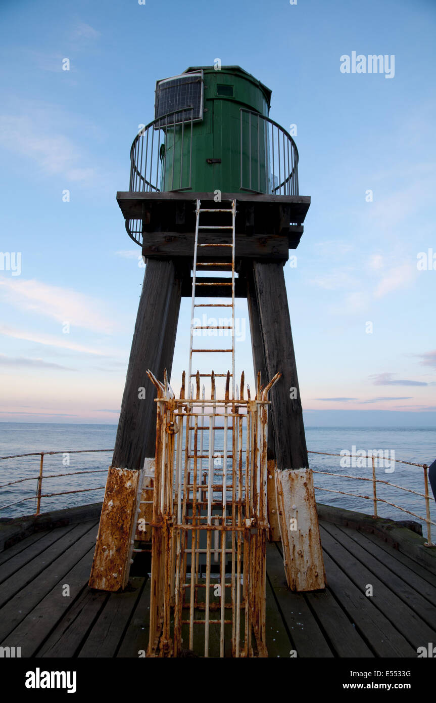 Early 20th century wooden lighhouse at end of pier, West Pier, Whitby, North Yorkshire, England, March - Stock Image