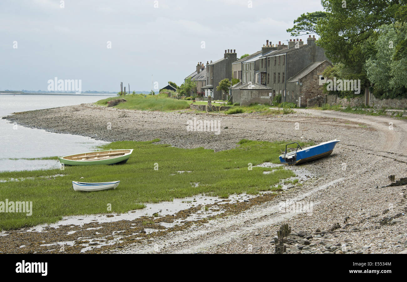 View of boats on shoreline and houses of coastal village, only community on U.K. mainland dependent upon tidal access, Stock Photo