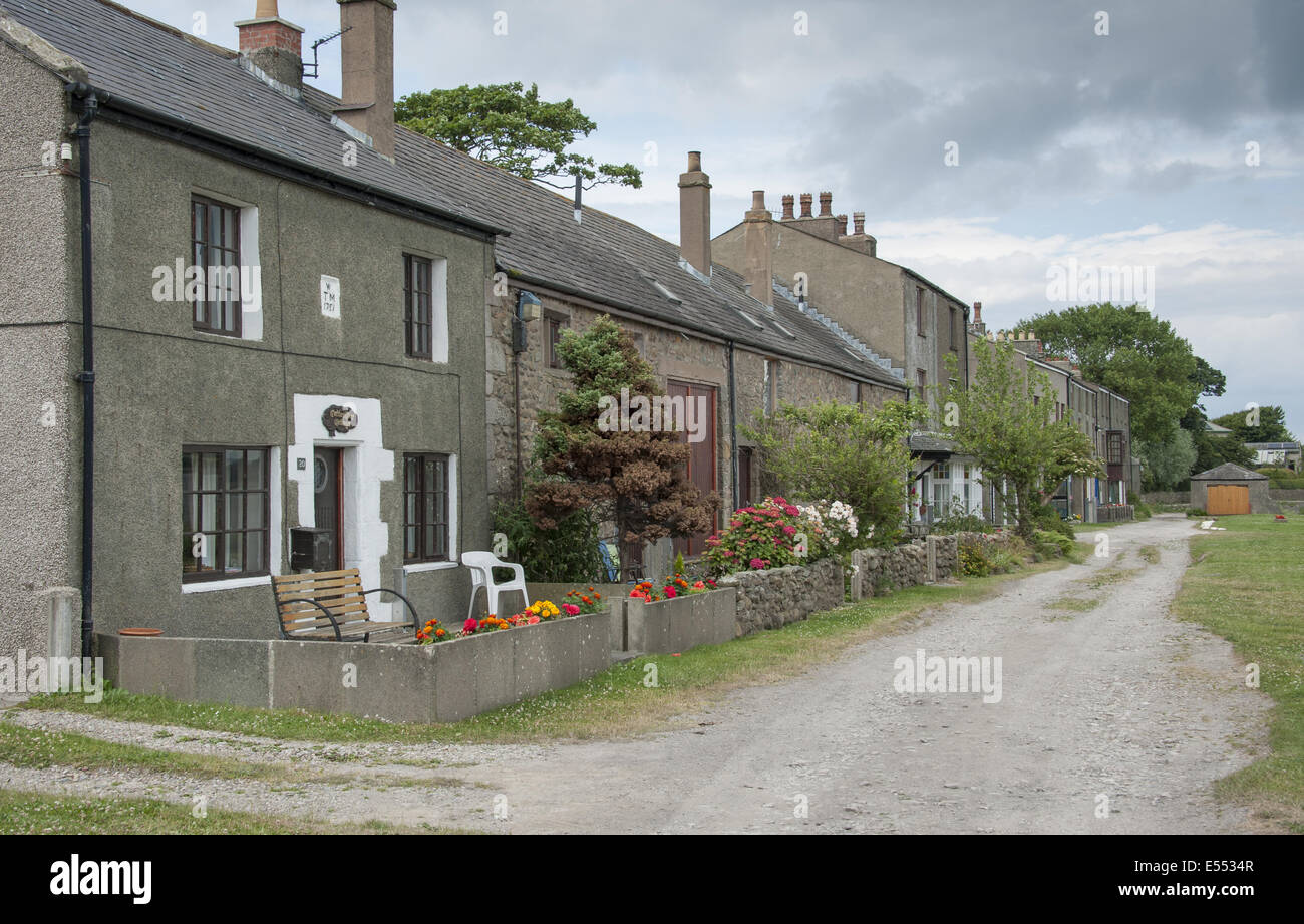 Houses in coastal village, only community on U.K. mainland dependent upon tidal access, with vehicular access to Stock Photo