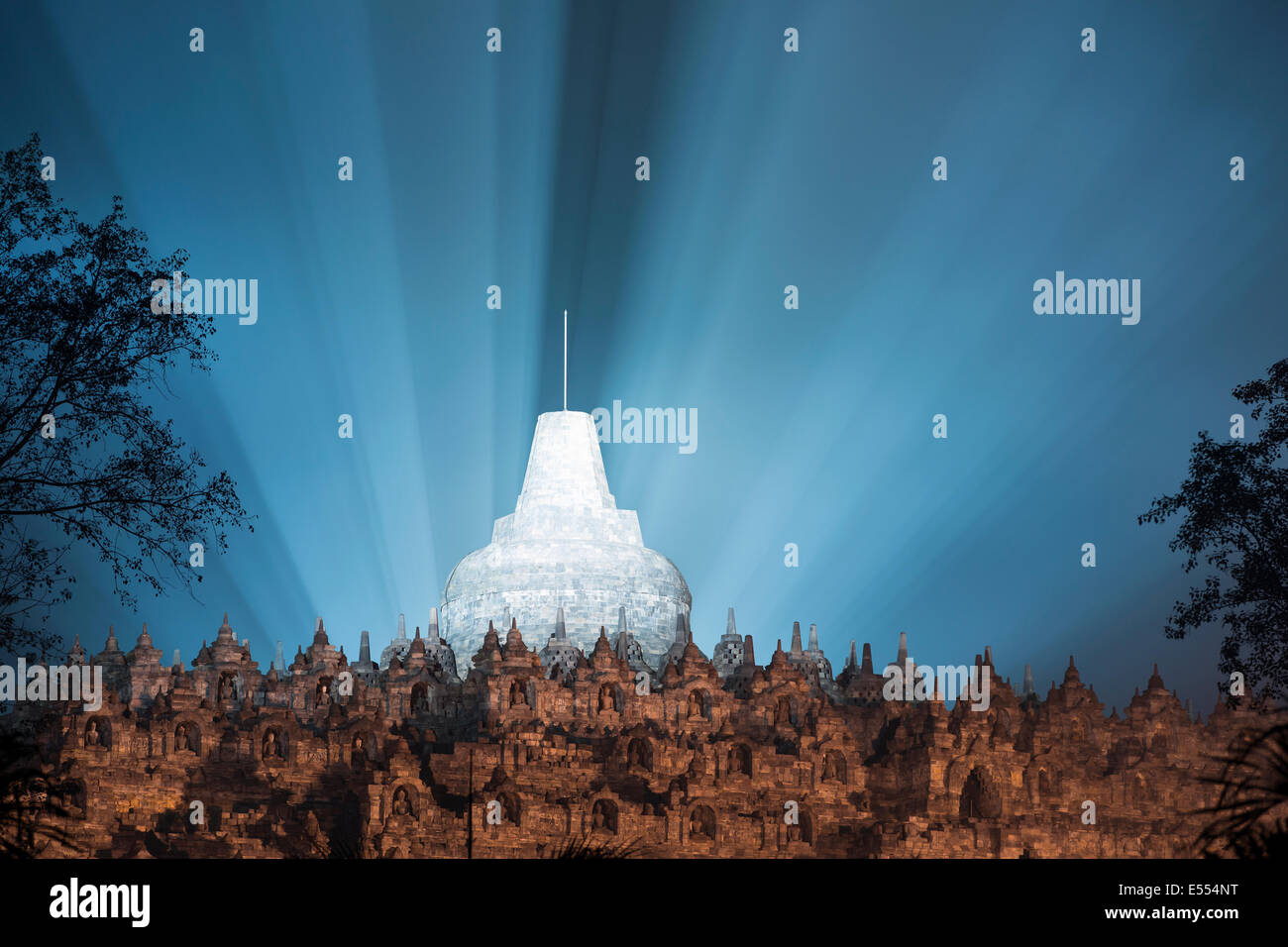 Borobudur spotlit through the smoke of firecrackers for takbiran at the end of Ramadan. Magelang, Central Java, - Stock Image