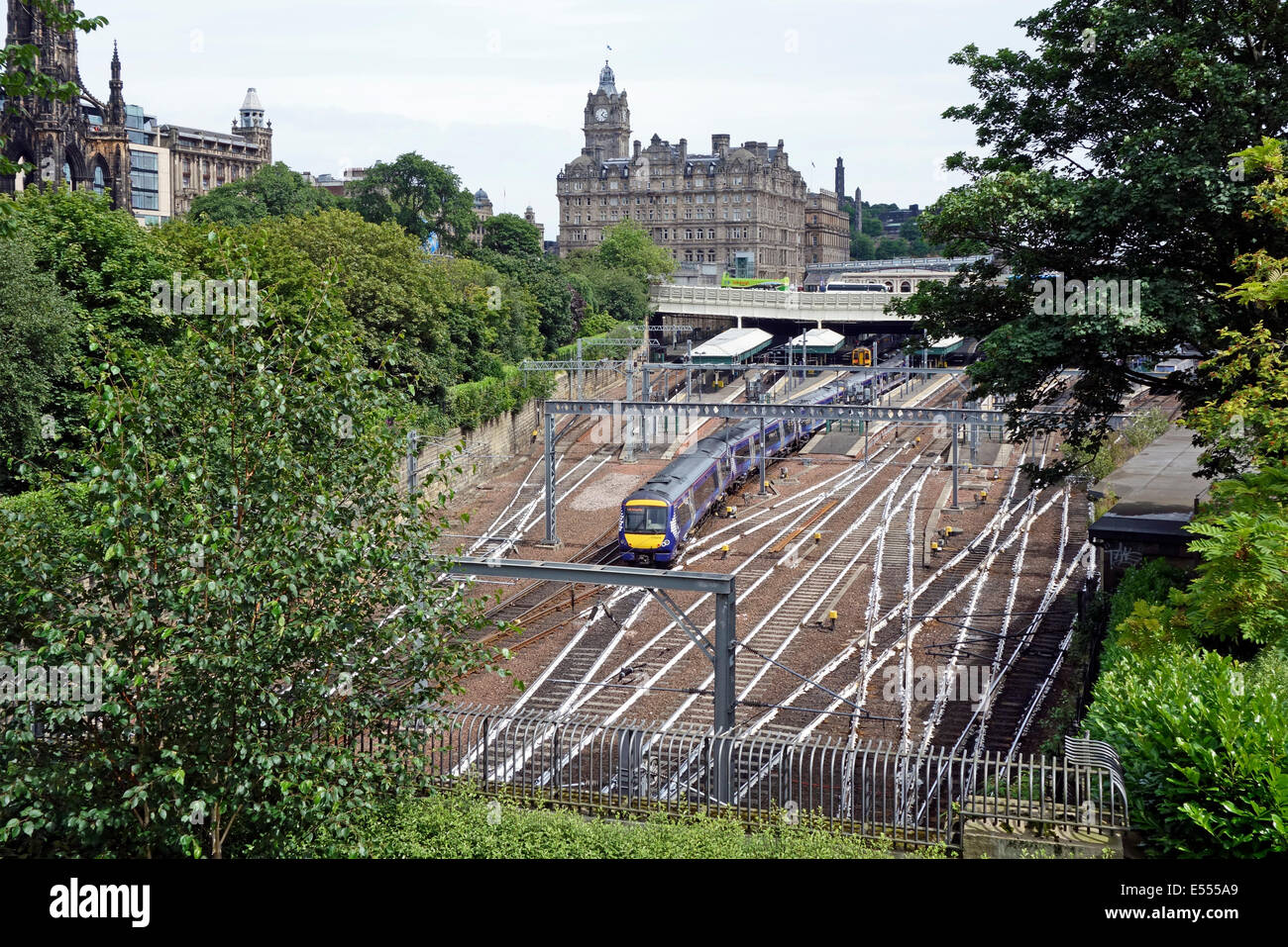 West end approach to Waverley Railway Station in Edinburgh Scotland with rails painted white - Stock Image