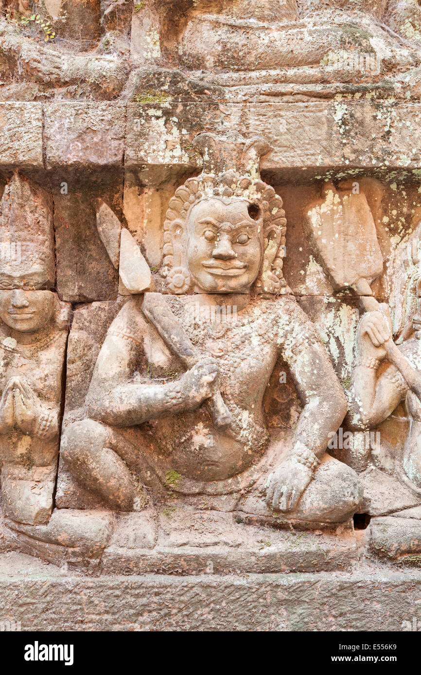 Bas-relief depicting a warrior on the hidden wall of the terrace of the elephants, Angkor Thom, Cambodia - Stock Image