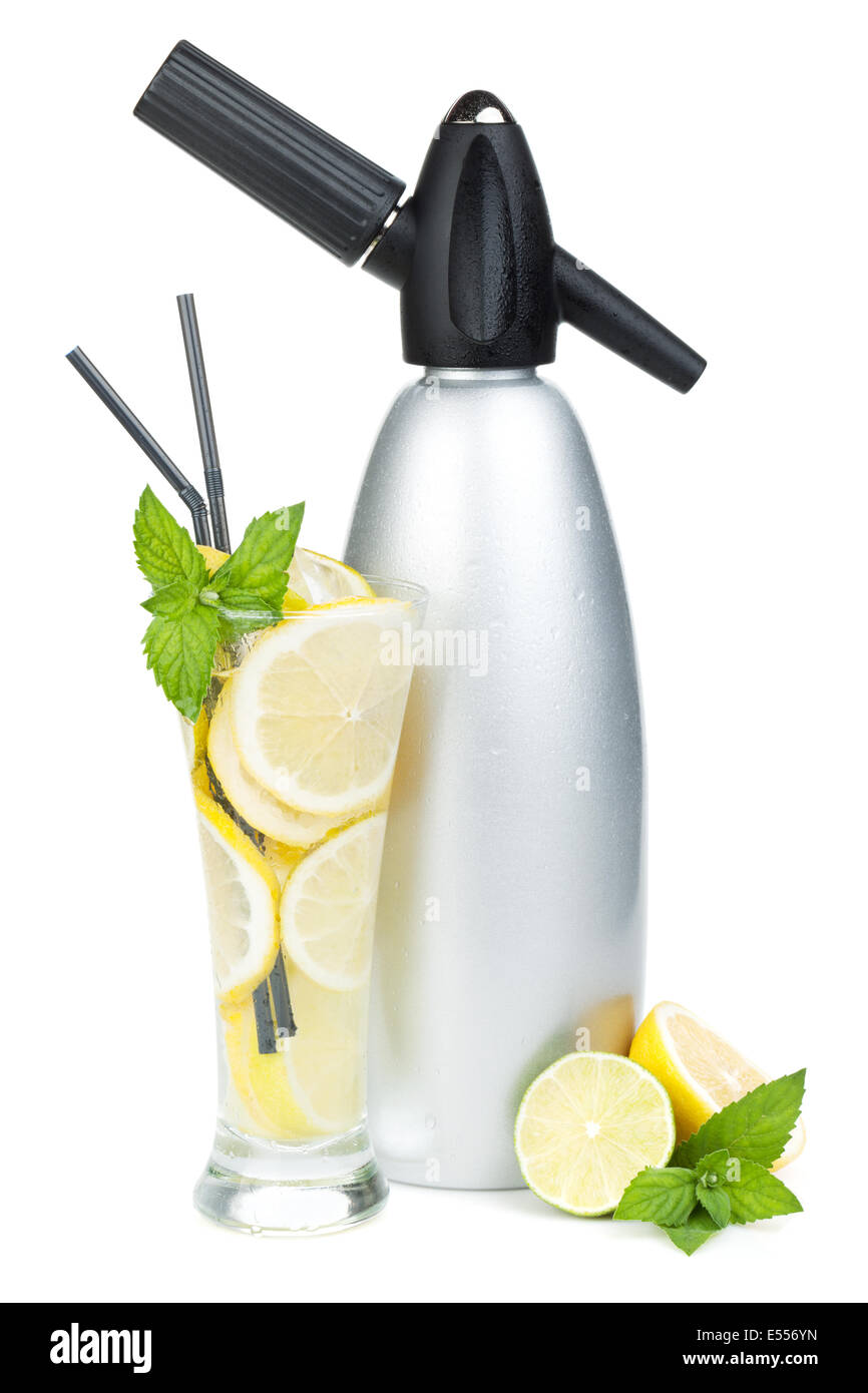 Glass with homemade lemonade and siphon. Isolated on white background - Stock Image