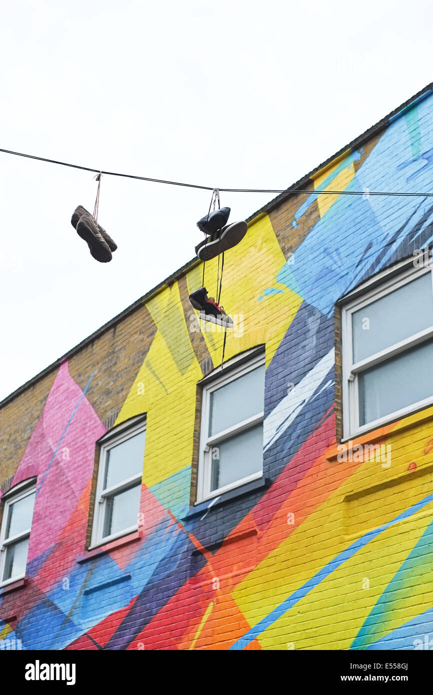 Shoreditch London Uk: Shoes Hanging From Cable Over Street In Shoreditch, East