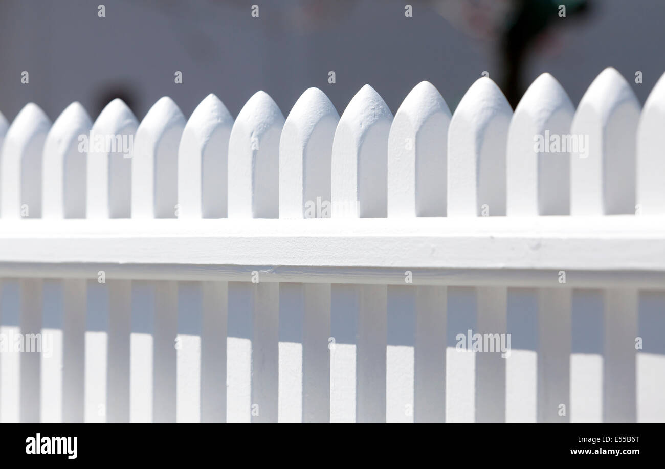 A white picket fence. - Stock Image
