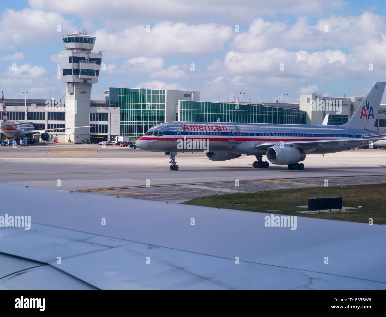Commercial passenger plane taxiing at airport - Stock Image