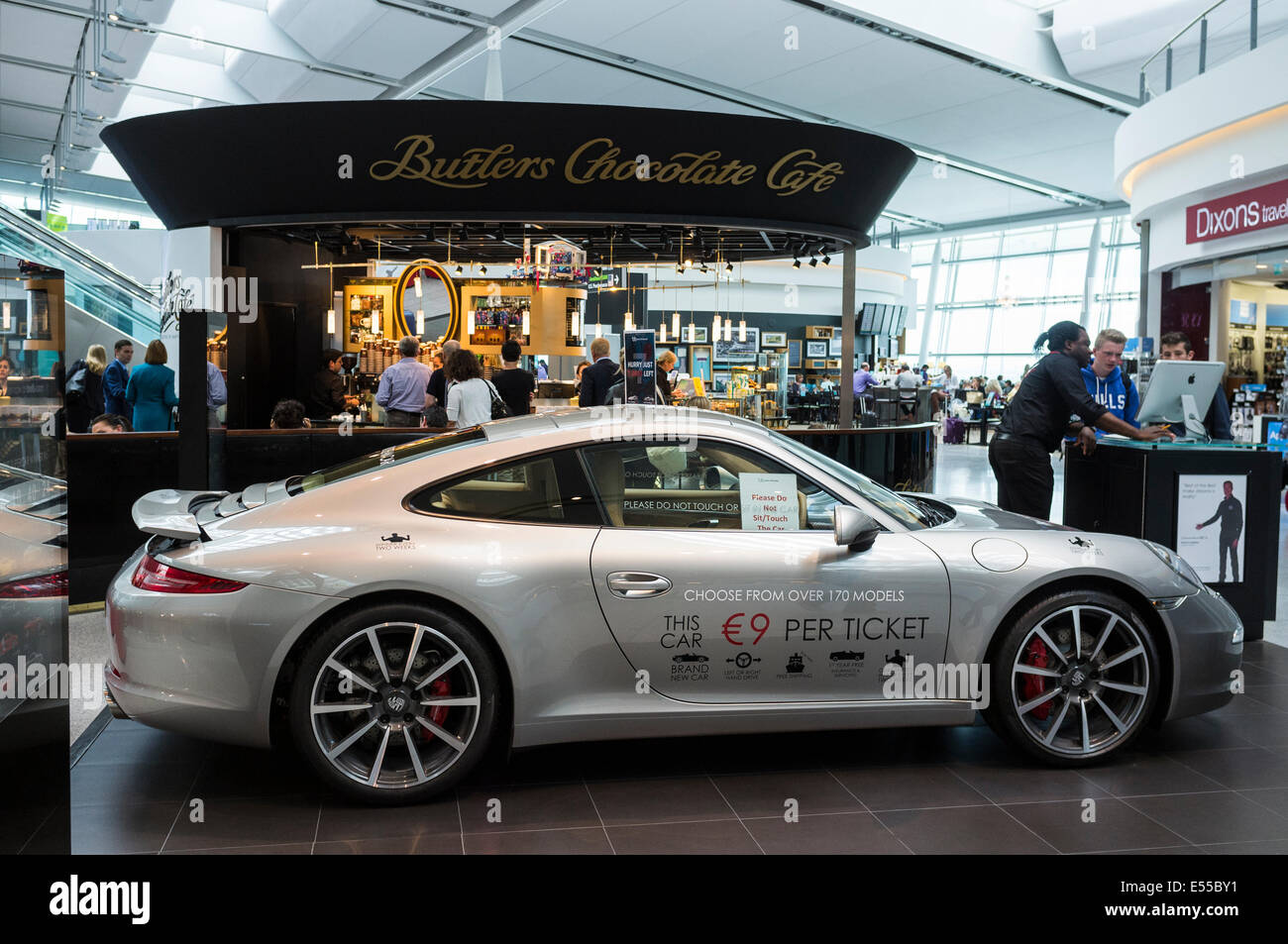 Porsche car on display as prize for lottery run at airport, airside at terminal 2 in Dublin airport, Ireland. - Stock Image