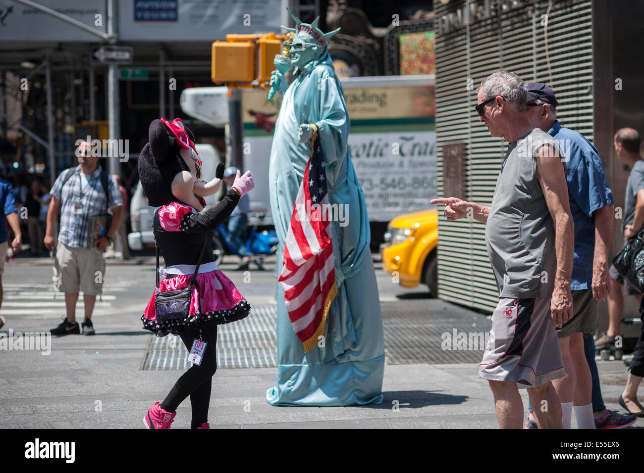 Costumed characters swarm Times Square in New York on Friday, July 18, 2014. - Stock Image