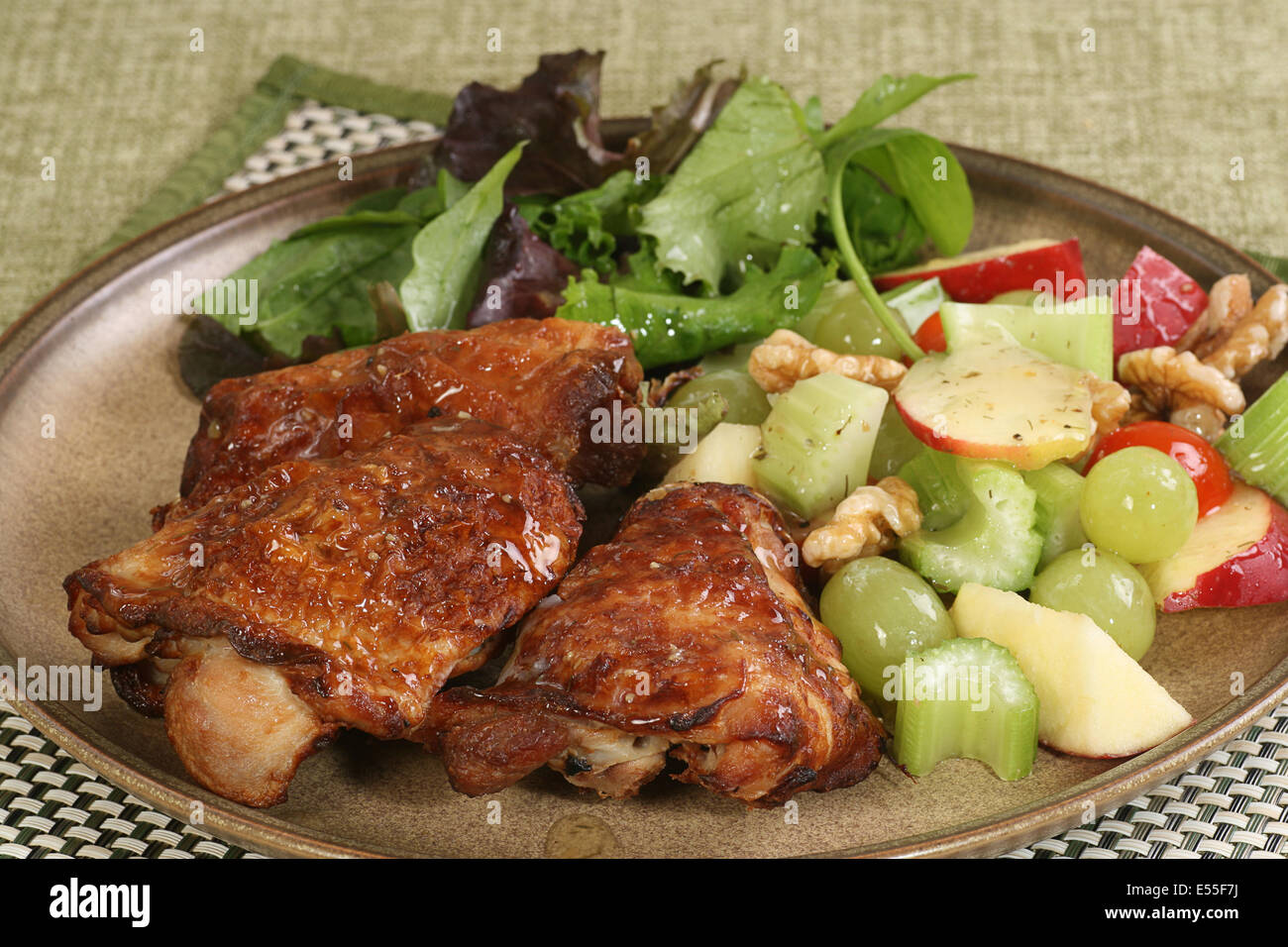 Roast chicken thighs with a mixed salad - Stock Image