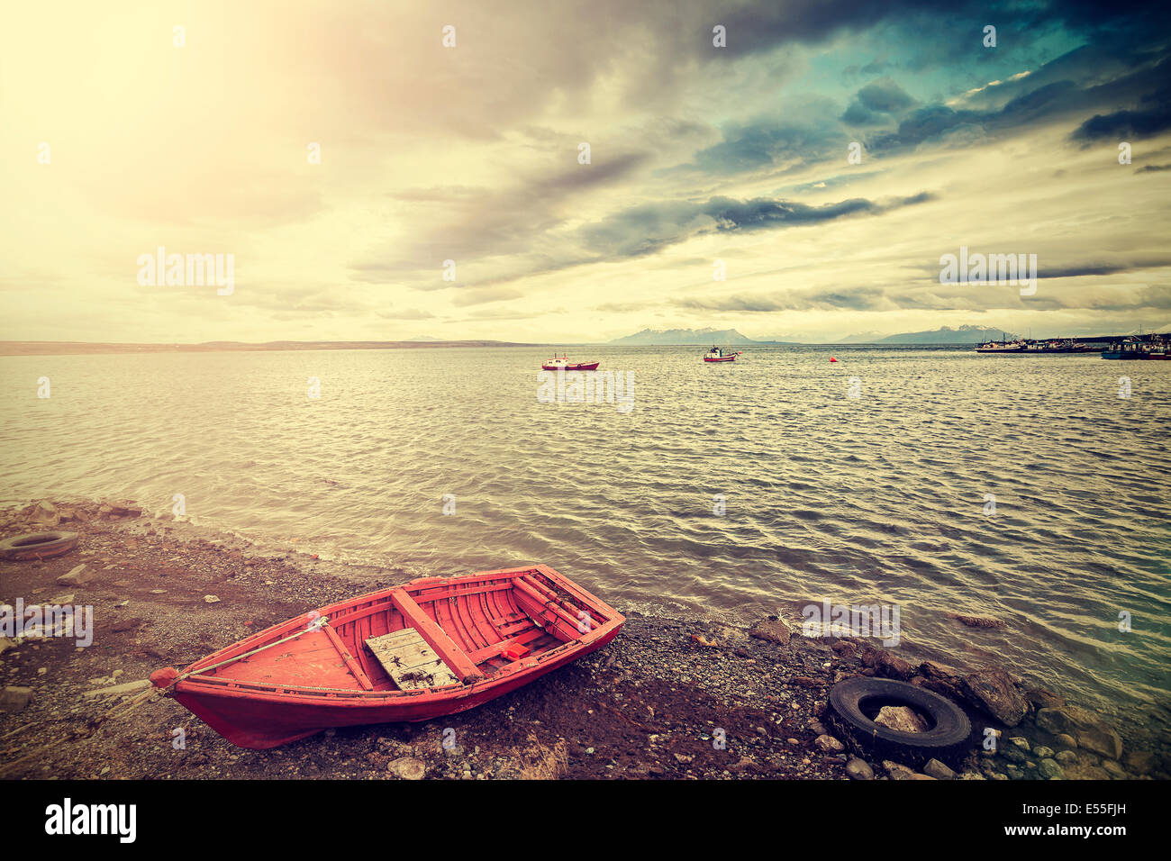 Vintage photo of a little fishing wooden boat - Stock Image