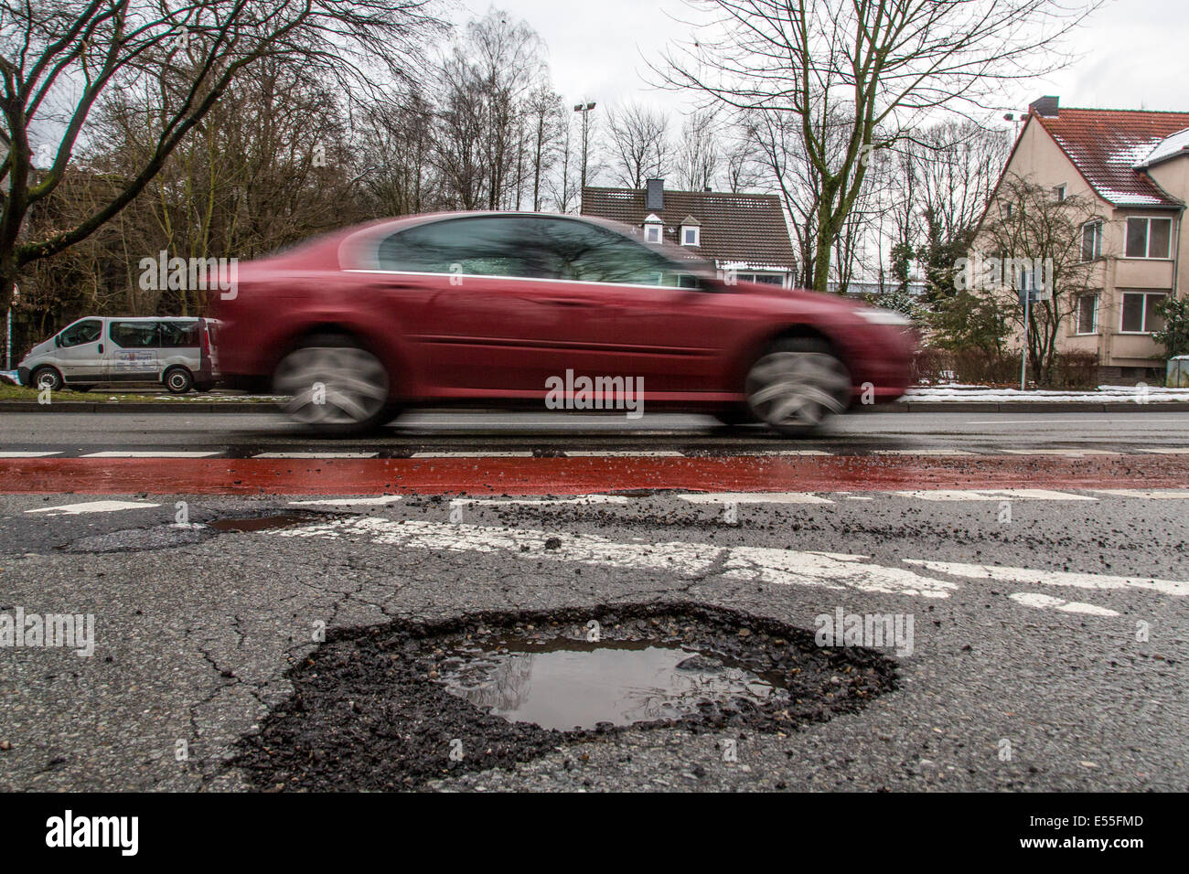 Road with potholes, inner city road, - Stock Image