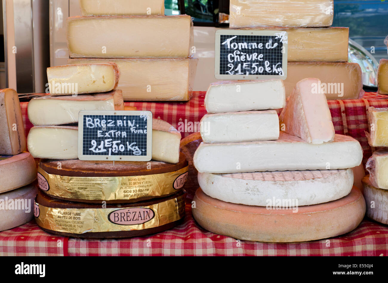 Smoked and Goat's cheese on a stall at the Saturday market in Chamonix, Haute Savoie, France. - Stock Image