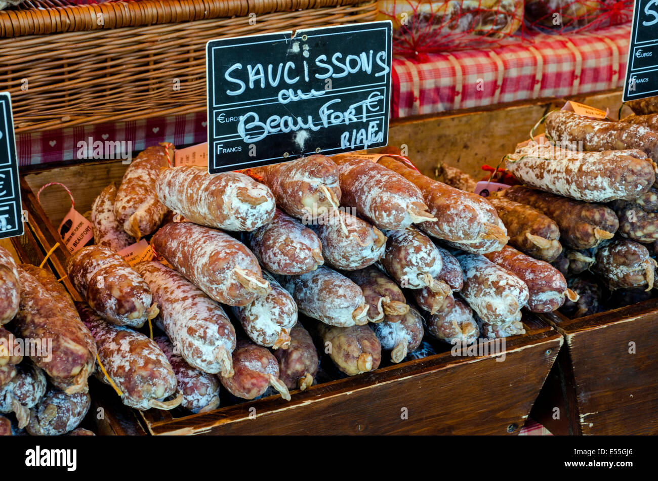 Saucisson au Beaufort, a traditional Savoy sausage flavoured with Beaufort cheese, on a stall in Chamonix, Haute - Stock Image
