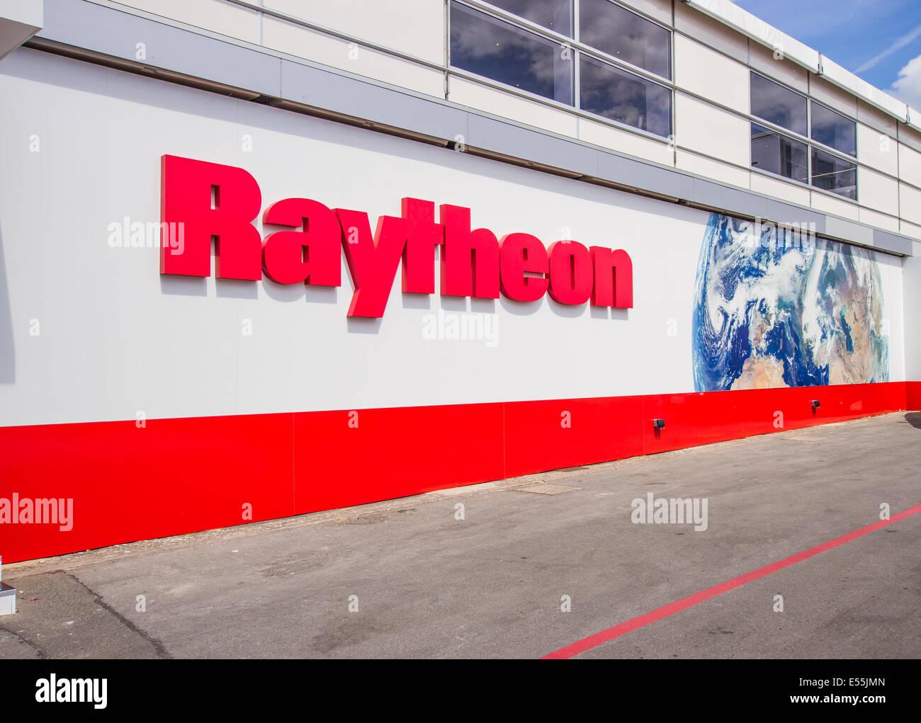Raytheon sign At Farnborough International Air Show July 15th 2014 - Stock Image