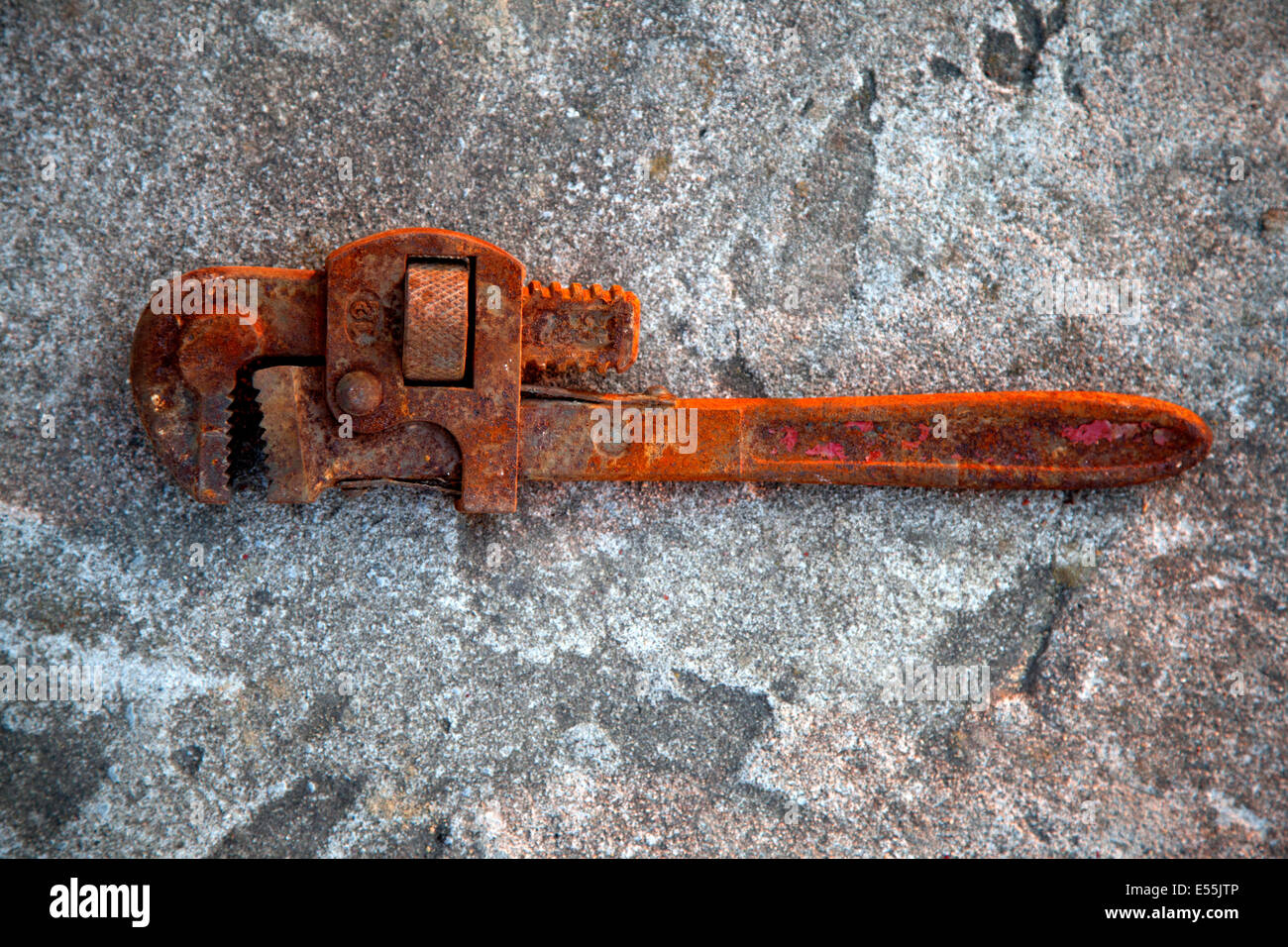 Thoroughly rusted forgotten pipe wrench. Zawady Poland - Stock Image