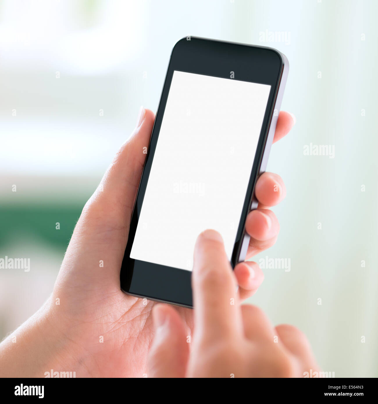 Female hands holding and touching on modern mobile smart phone with blank screen. Isolated on white background. - Stock Image