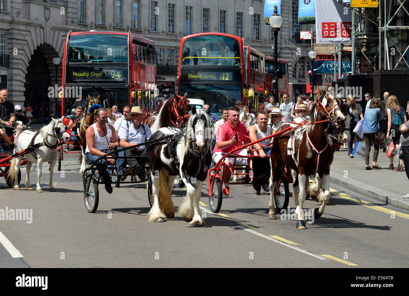 London, England, UK. Pony trotting carriages being driven down Regent Street - Stock Image
