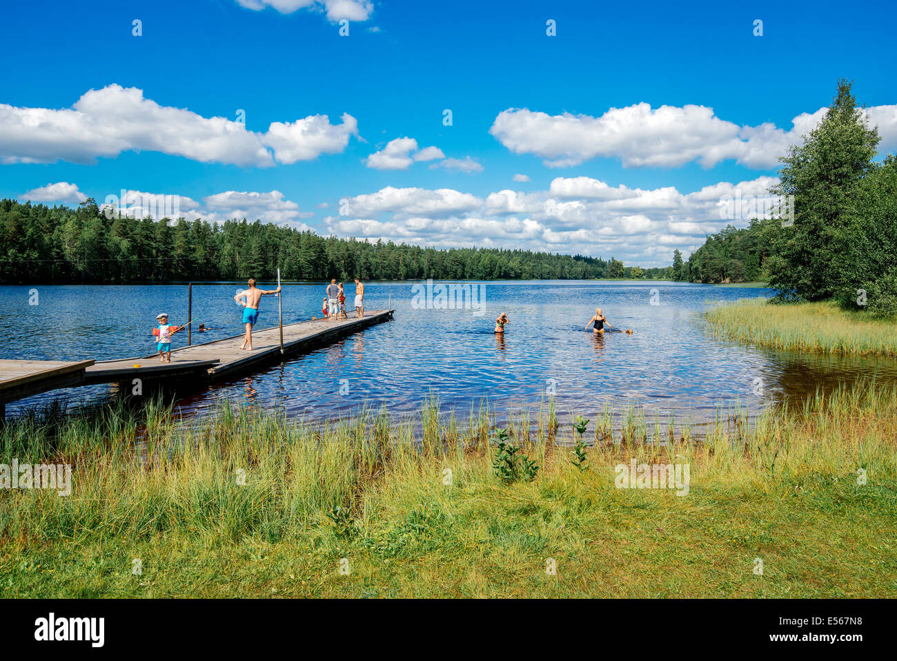 Summer in Sweden - people enjoying a sunny day by a lake - Stock Image