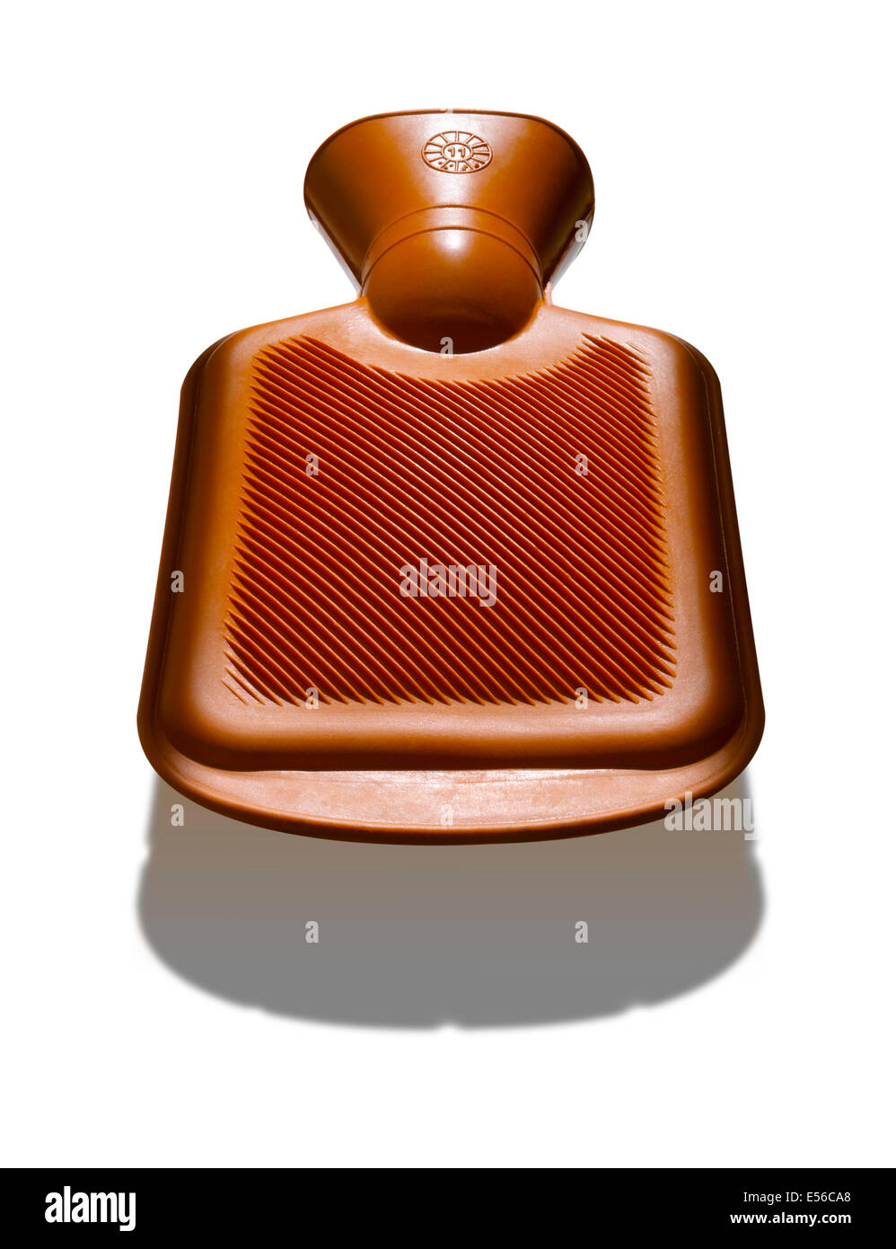 A an orange hot water bottle with strong shadow below Stock Photo