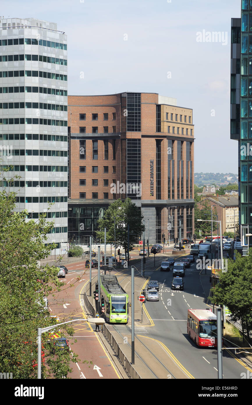 A tram travels down Wellesley Road, Croydon, UK. A modern, urban dual carriageway with tall office blocks on both - Stock Image
