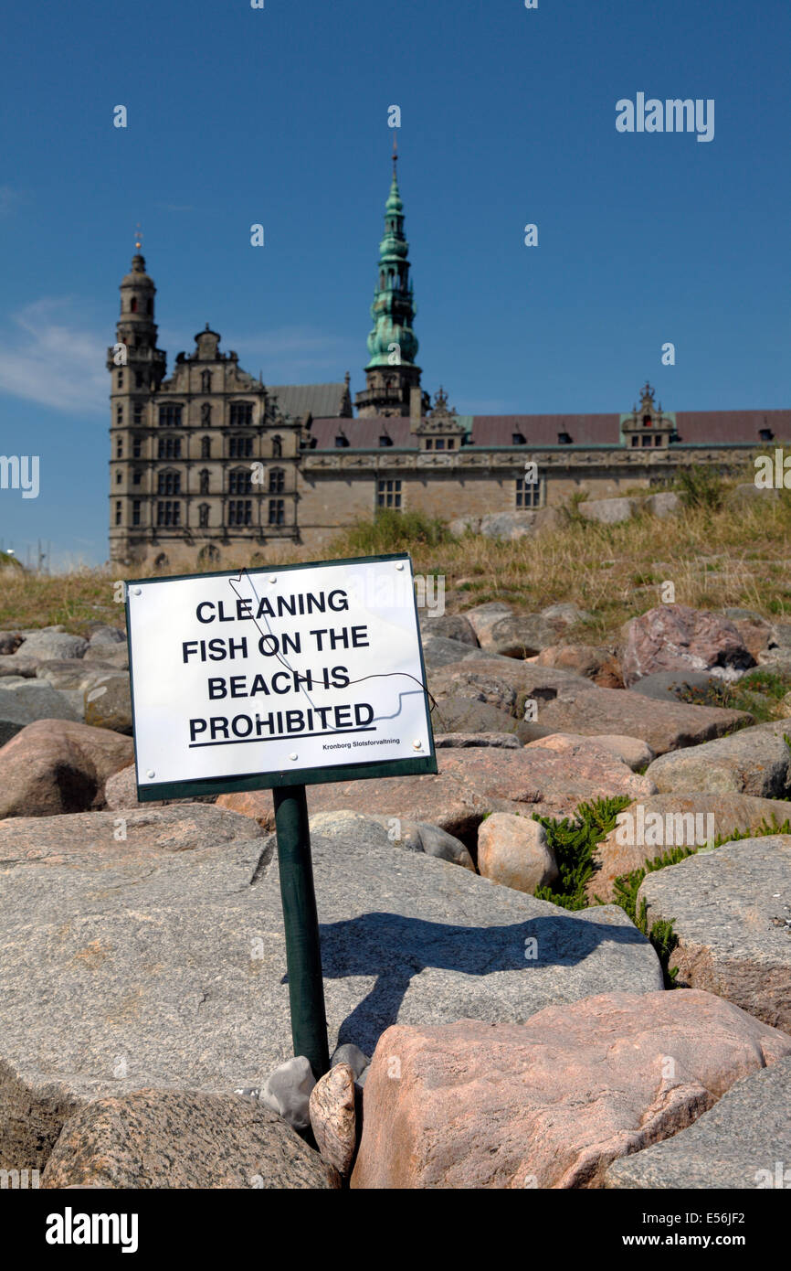 Sign on the beach at Kronborg, Elsinore, Denmark, a very popular fishing point for anglers. Castle Kronborg in the - Stock Image