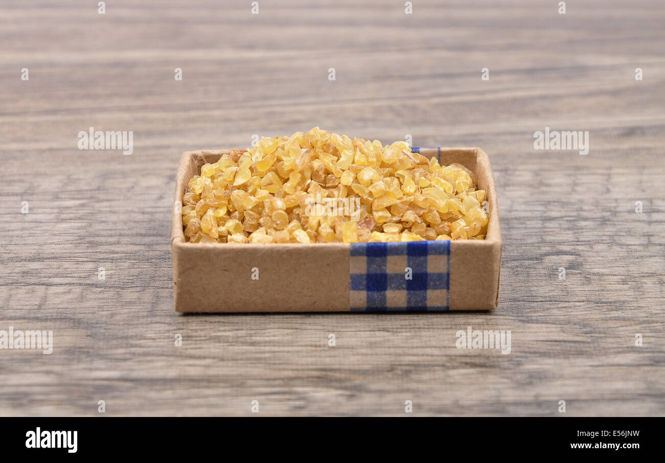 Wheat groat on wood - Stock Image