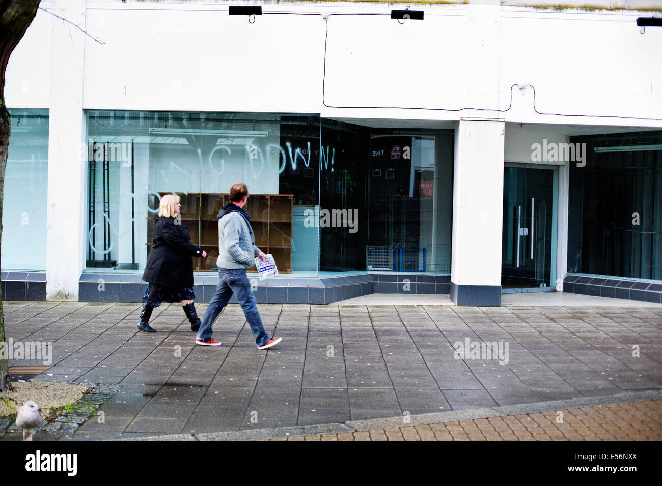 A run down street in Plymouth showing empty closed down shops Stock Photo