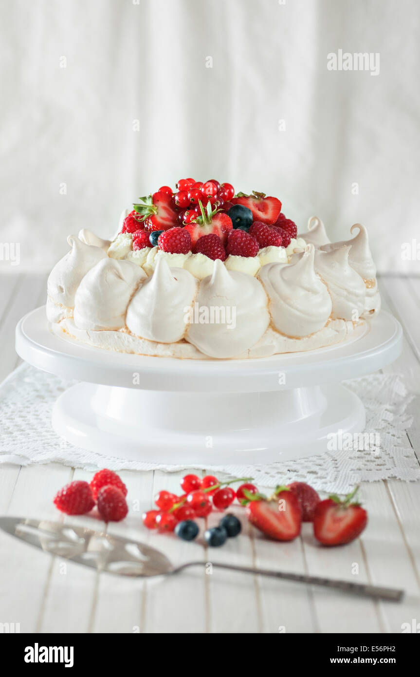 Summer fruit pavlova. Meringue and cream dessert - Stock Image