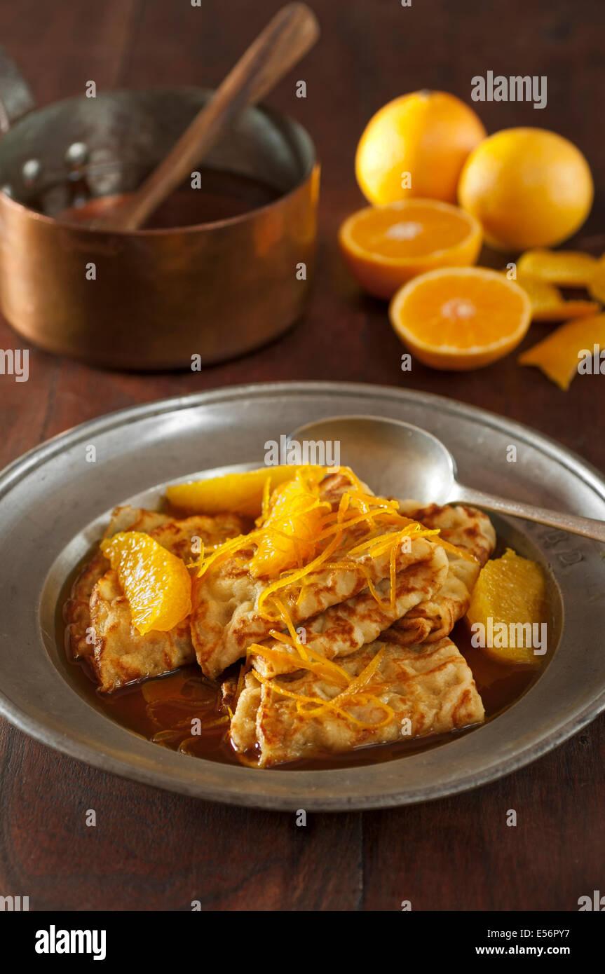 Crêpes Suzette. Pancakes with oranges and orange liqueur - Stock Image