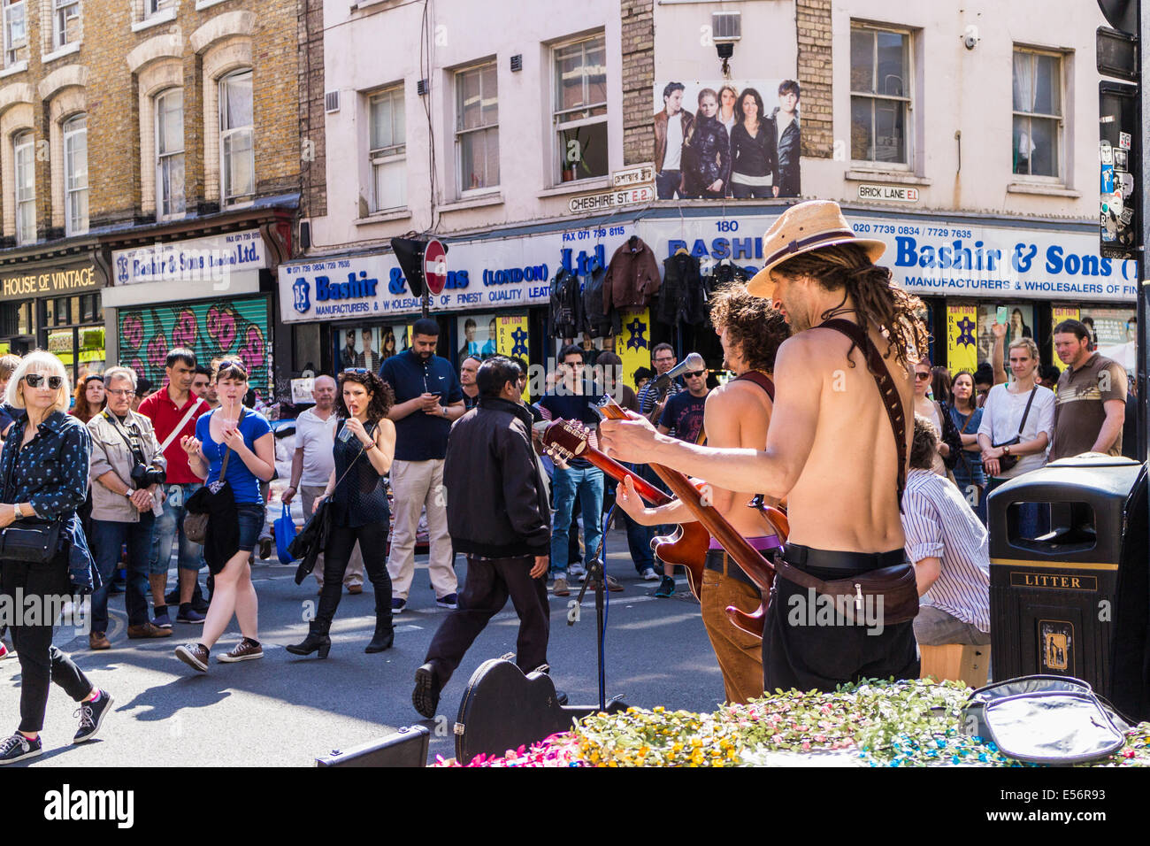 Street entertainers on Brick Lane - London - Stock Image