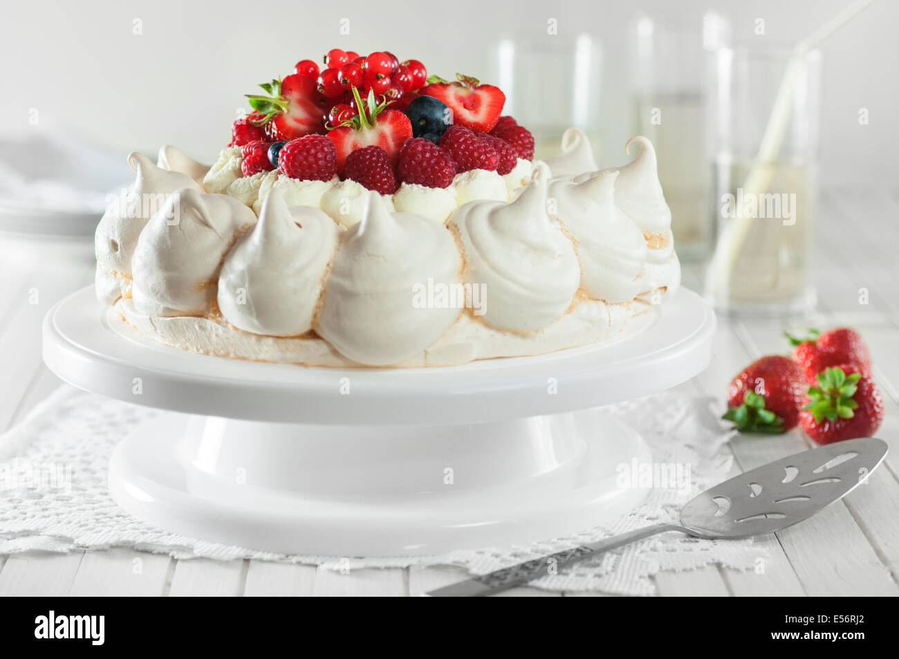 Summer fruit pavlova. Meringue and cream dessert - Stock Image