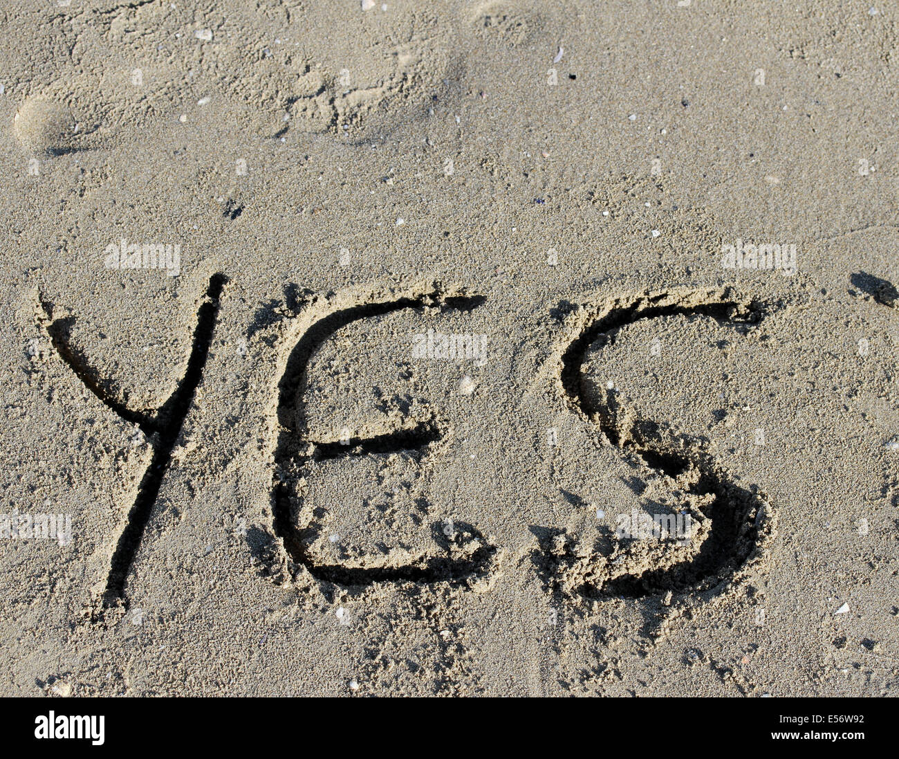 great written YES engraved on the sand of the Sea Beach - Stock Image