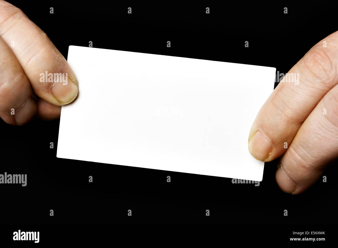 Blank business card in hands over black background Stock Photo ...