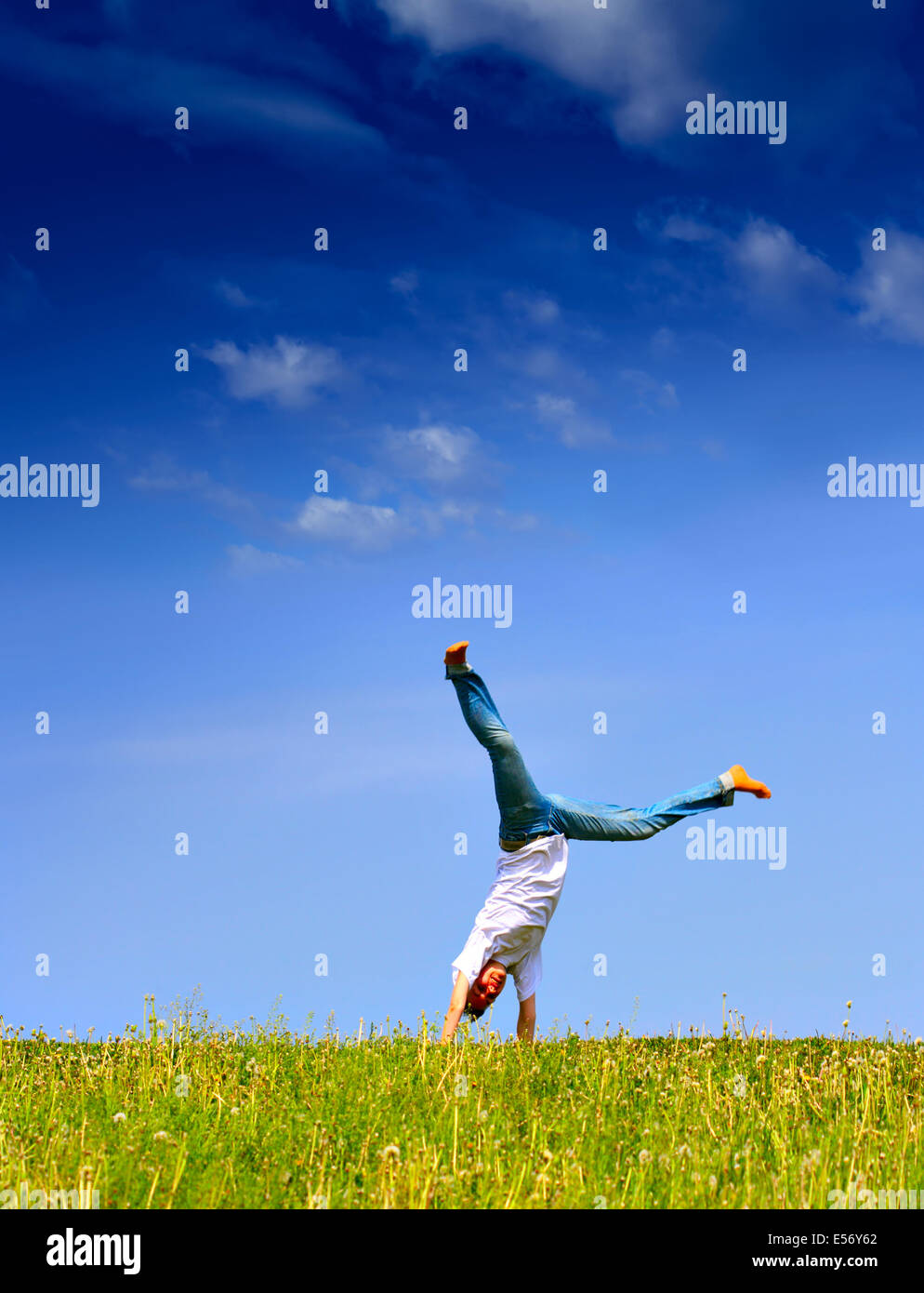 Freedom - Young girl have fun on the flank of hill - Stock Image