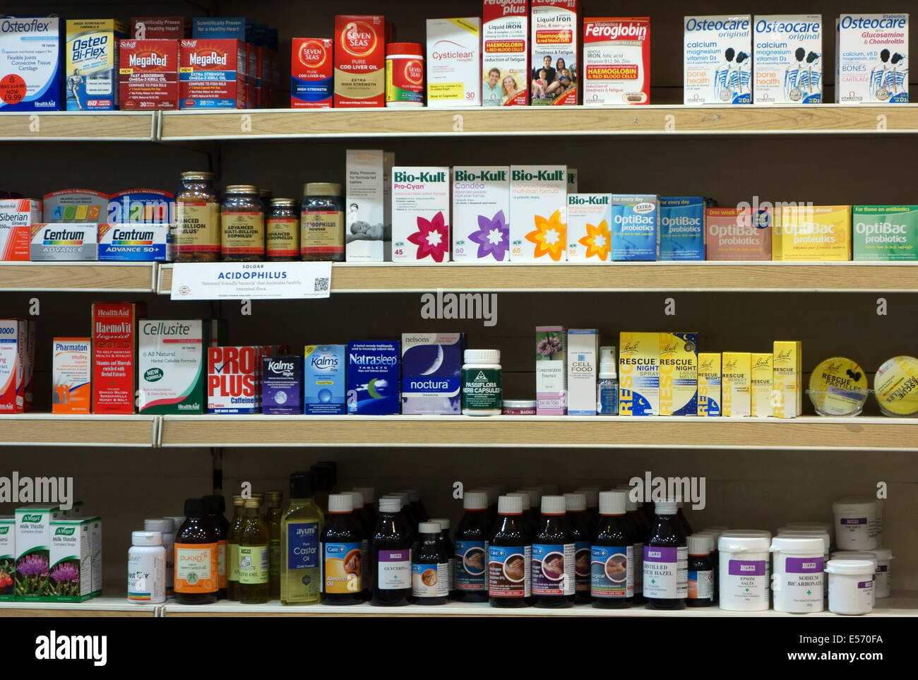 Over-the-counter medicines displayed in London chemists shop - Stock Image