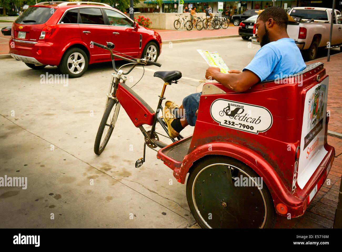 Savannah Pedicab driver takes a break to study a map at ... on savannah georgia restaurants, savannah georgia food, atlanta georgia attractions map, savannah tourist map, savannah georgia things to do, columbus georgia attractions map, river street savannah ga map, savannah georgia overview, georgia beach map, savannah ga zip code map, savannah georgia museums, savannah georgia horseback riding, savannah georgia historic district, savannah neighborhoods map, savannah ga map location, savannah georgia boat tours, savannah restaurants map, savannah georgia shopping, savannah georgia botanical gardens, savannah georgia galleries,