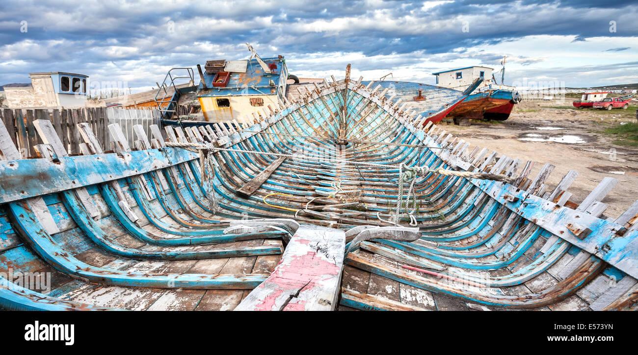 Shipwreck on Old Boat Scrap Yard. - Stock Image