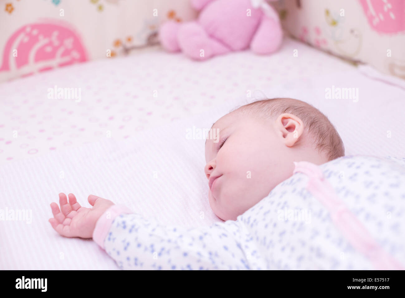 cute baby girl sleeping in her crib stock photo: 72072371 - alamy