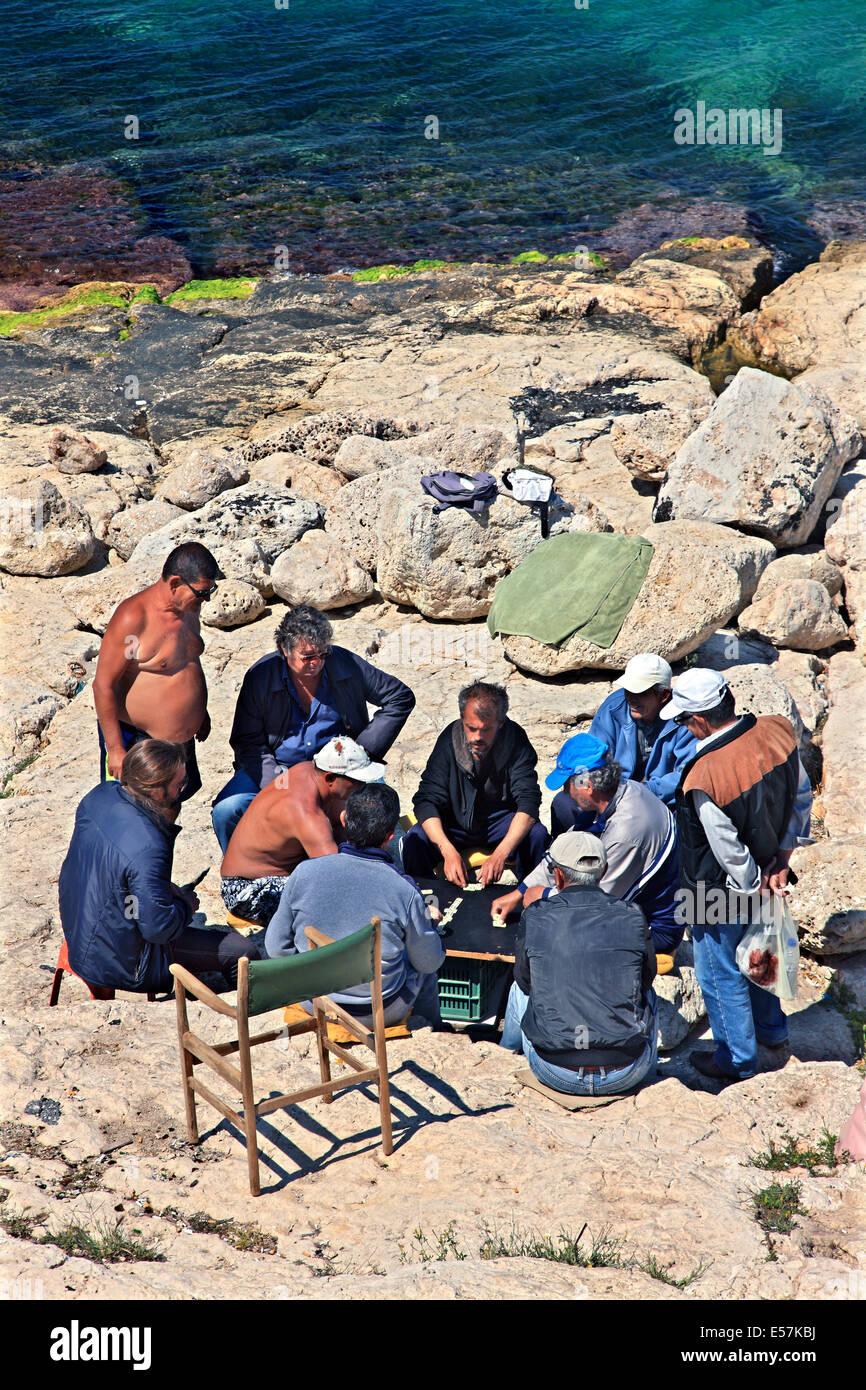 Playing domino at the rocks of Piraiki, Piraeus, Attica, Greece. - Stock Image