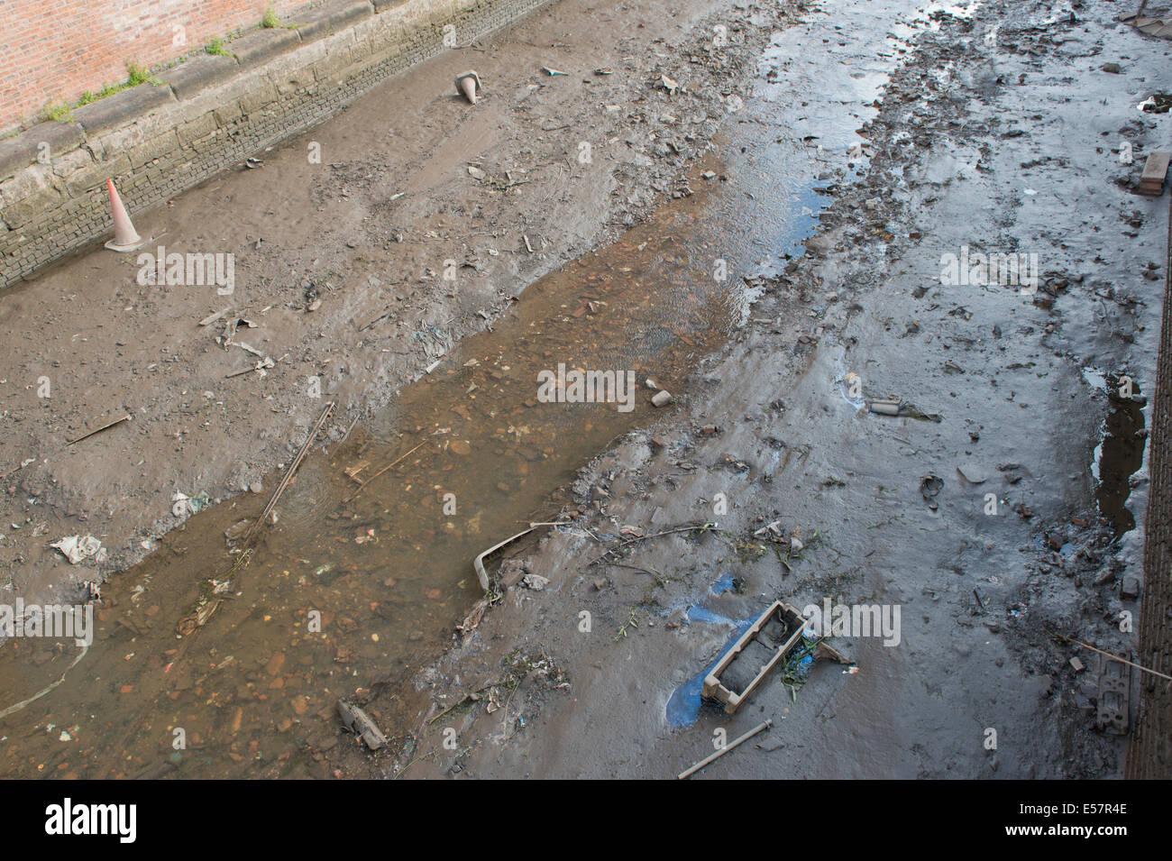 Vandals drained a part of the Rochdale canal near to the Ancoats area of Manchester, UK. - Stock Image