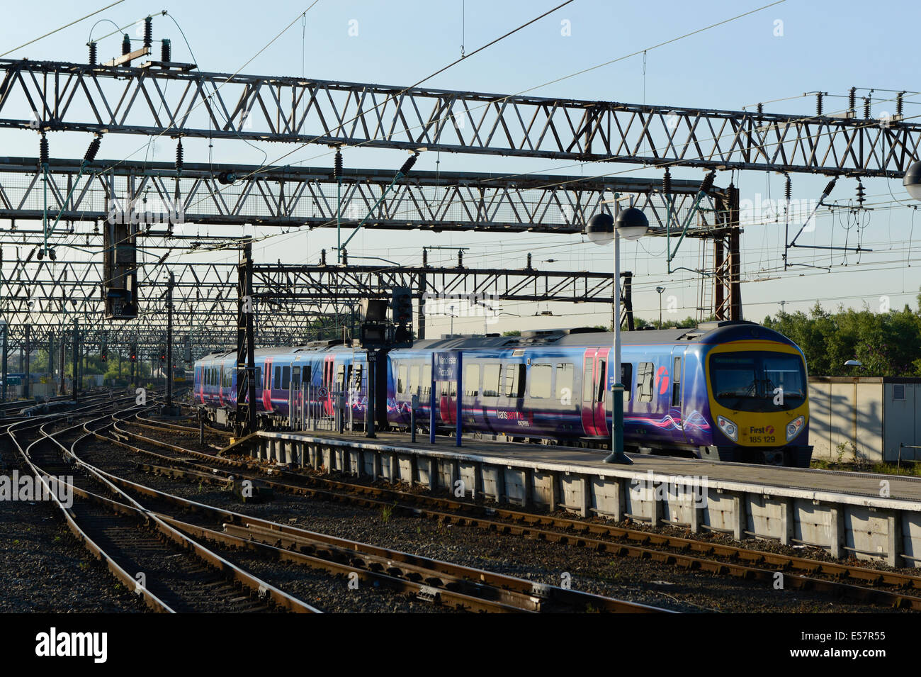 A First TransPennine ADtranz / Bombardier Express Class 170 Turbostar enters Manchester Piccadilly Rail Station. - Stock Image