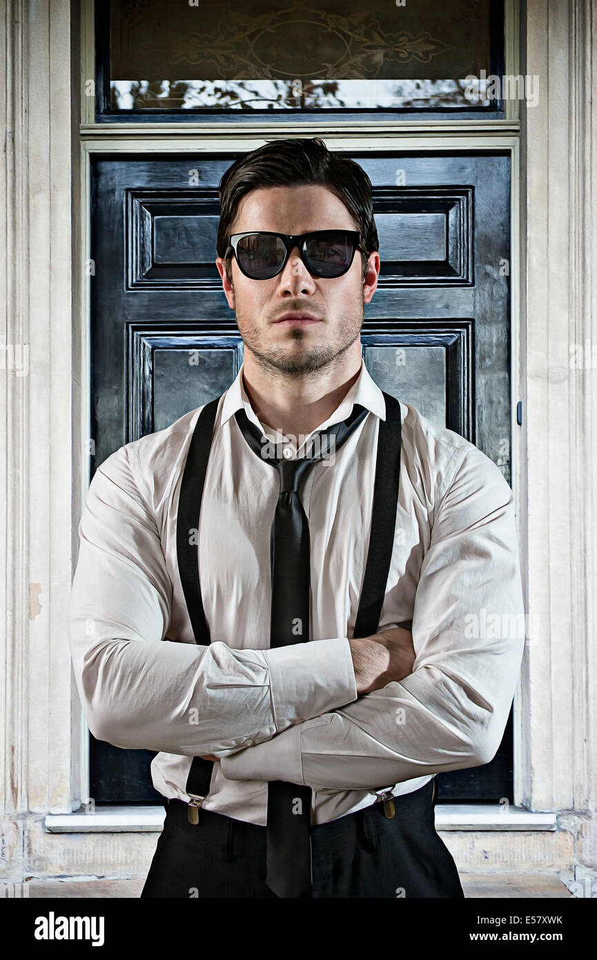Security guard protects the door of as club - Stock Image
